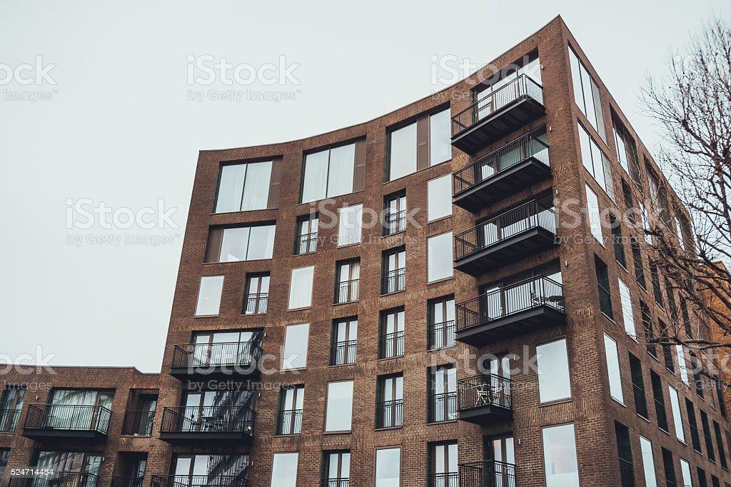 Modern Apartment Building Facade modern apartment building with curved facade stock photo 524714454