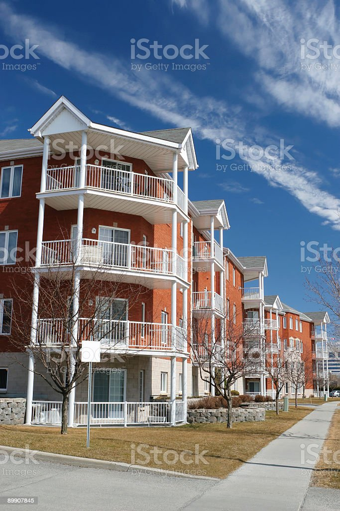 Modern Apartment Building with sidewalk royalty-free stock photo