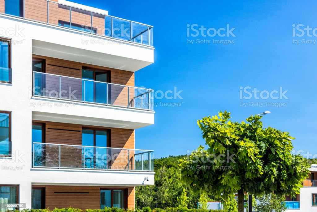 Modern apartment buildings in the park stock photo