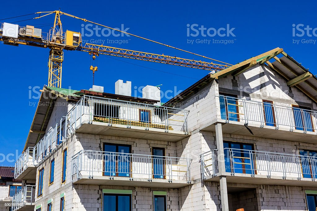 Modern apartment buildings under construction stock photo