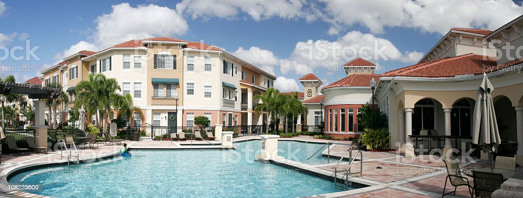 Modern apartment complex with pool and patio areas stock photo
