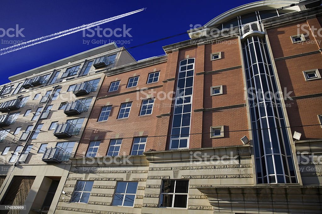 Modern Apartments with Airplane-More below royalty-free stock photo