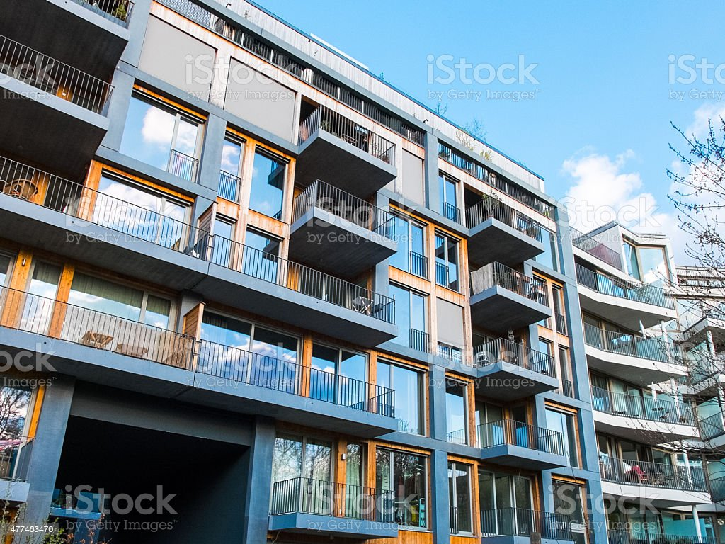 modern apartments with balconys and blue sky stock photo
