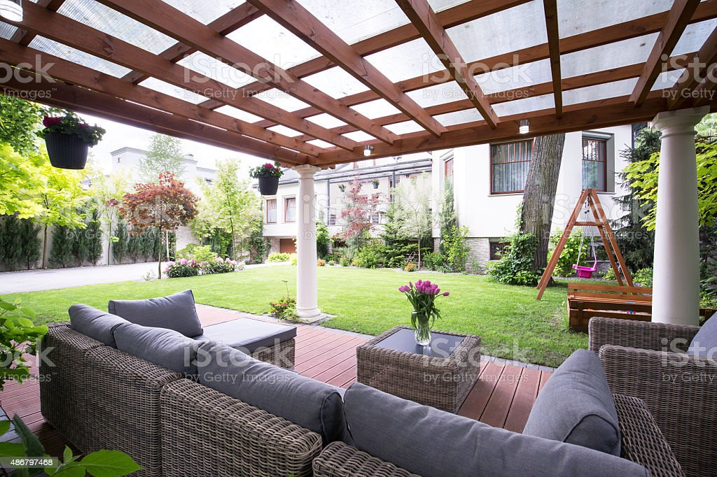 Modern arbour with garden furniture stock photo