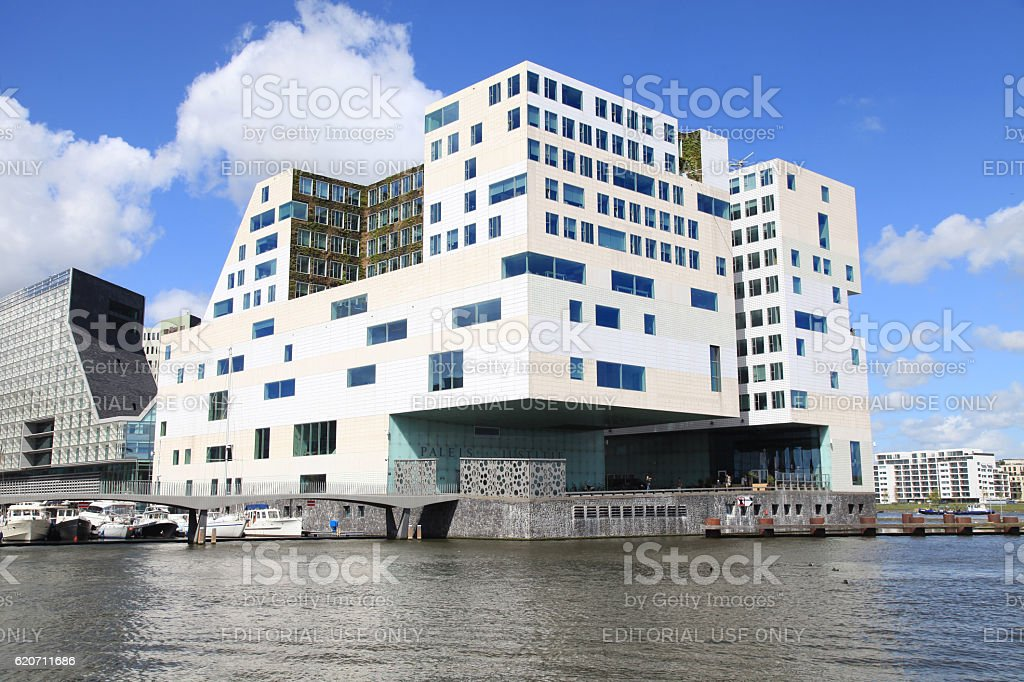 Modern architecture and Amstel river on IJdock district in Amsterdam stock photo