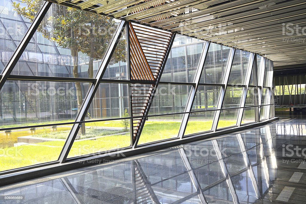 Modern architecture at glass wall corridor backgroundsm stock photo