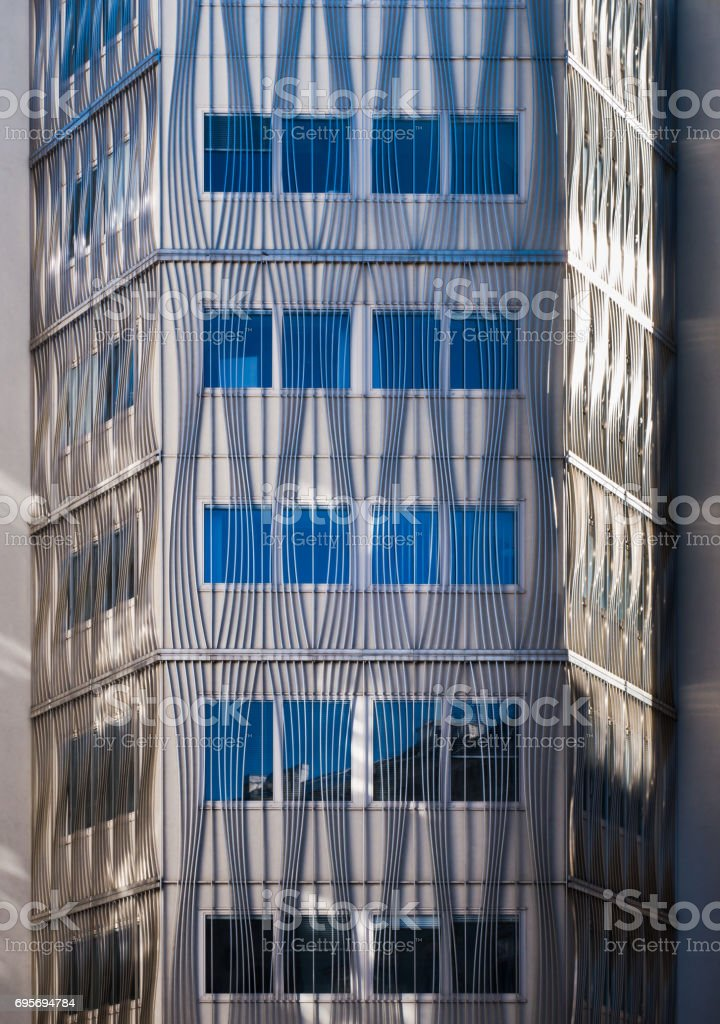 Modern architecture building front of with vertical and curved lines stock photo