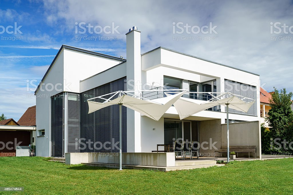 Modern Architecture Home on Green Summer Meadow stock photo