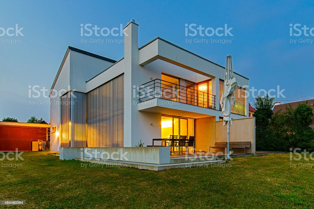 Modern Architecture House Home Illuminated at Twilight stock photo