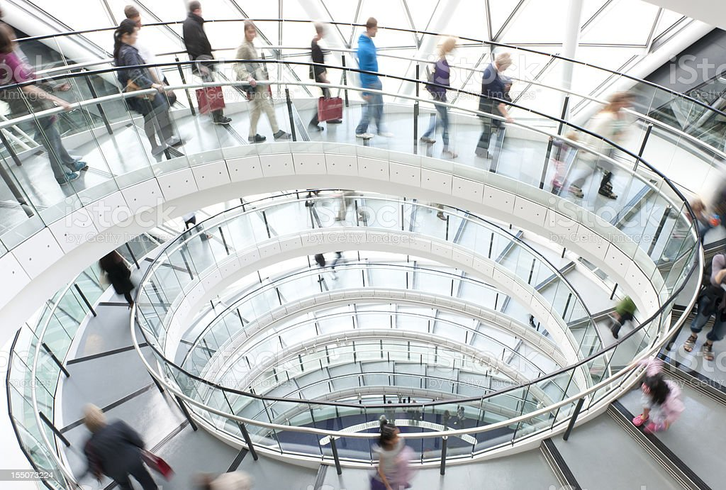 Modern Architecture Spiral Staircase with People stock photo