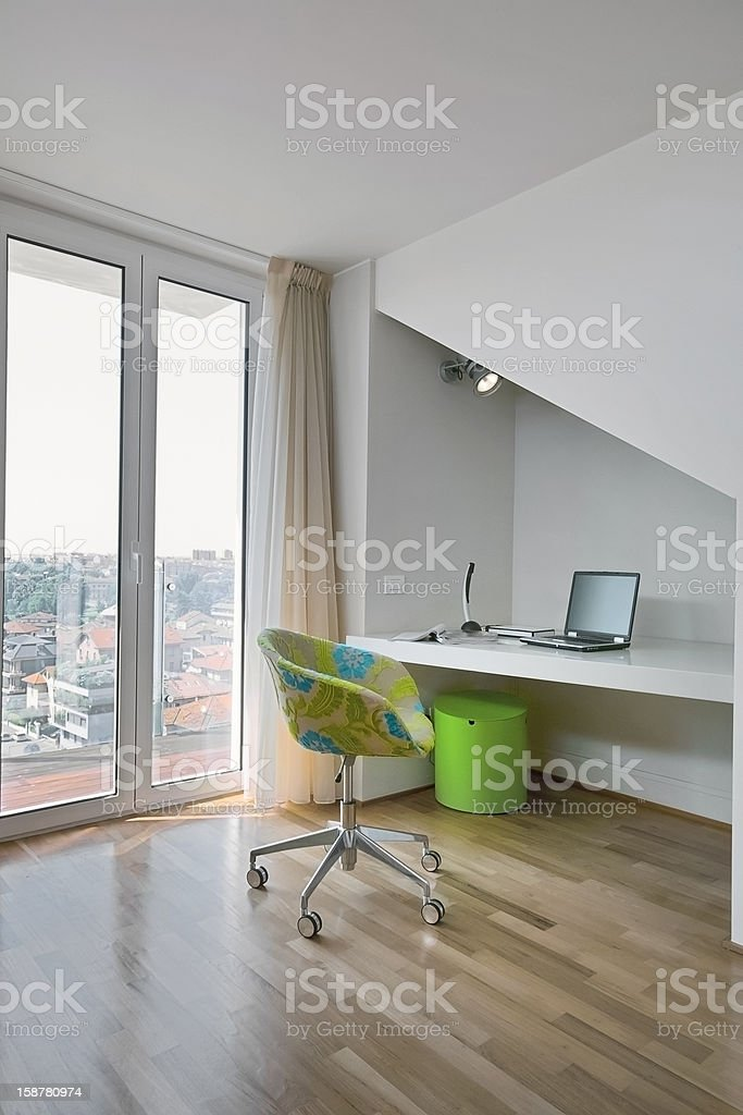 modern armchair and desk in garret stock photo