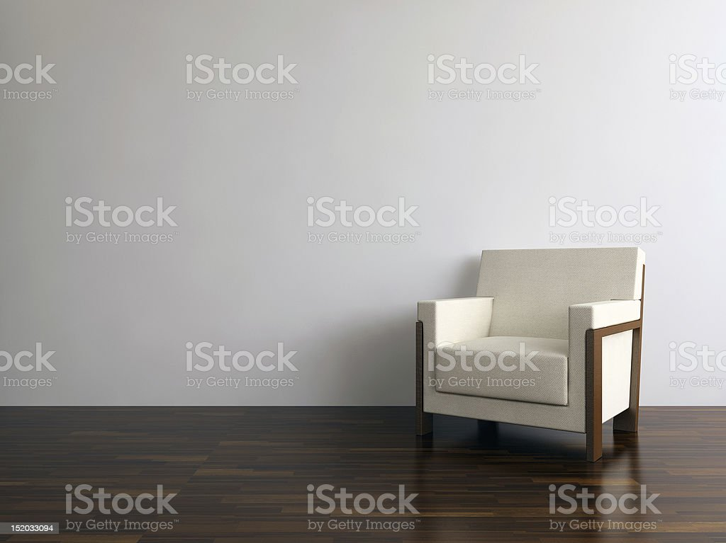 Modern Armchair to face a blank wall royalty-free stock photo