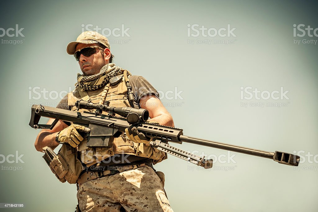 Modern Army Sniper Standing Tall with Barrett M82A1 Precision Rifle stock photo