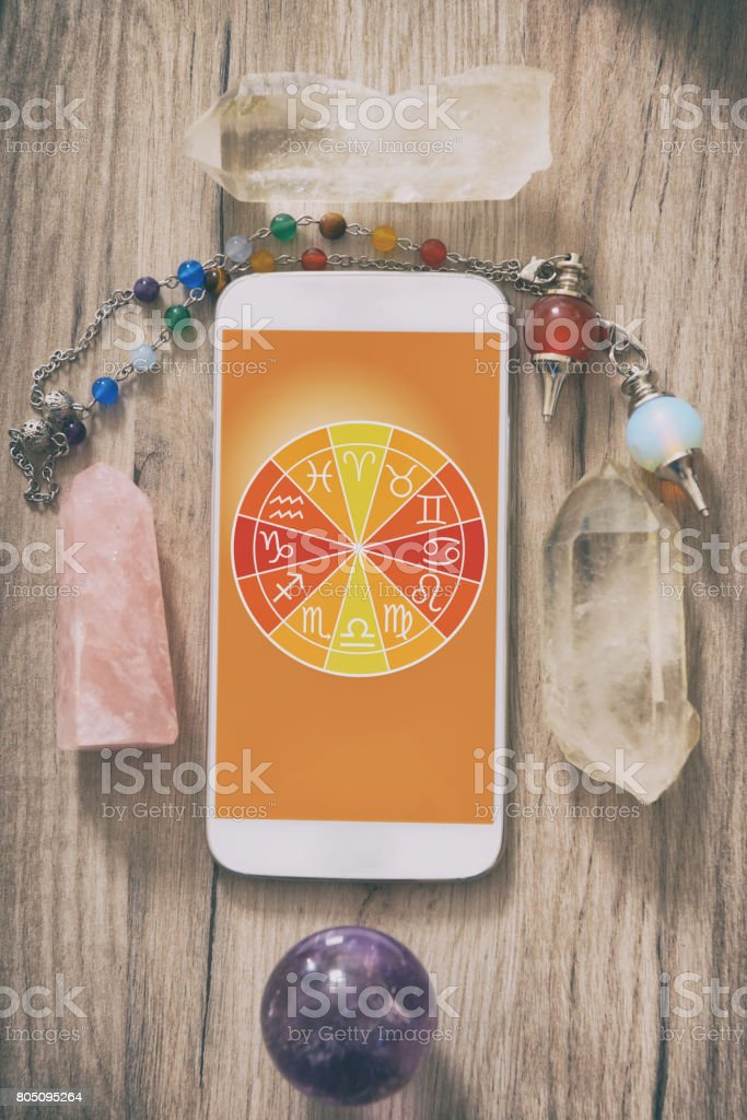 Modern astrology concept with mobile stock photo