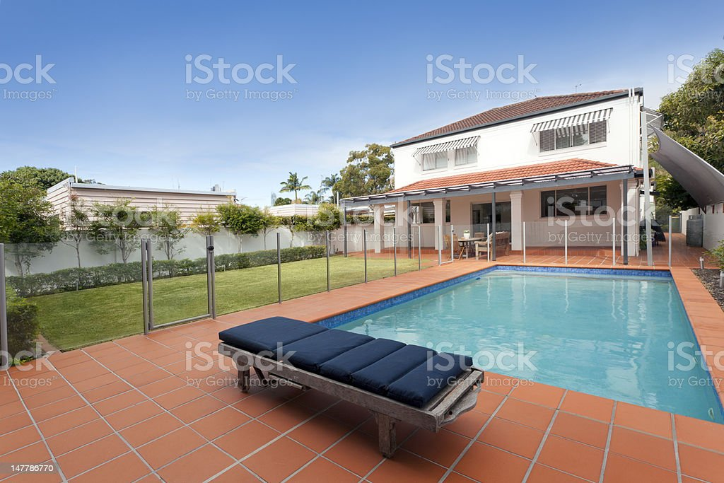 Modern backyard with pool royalty-free stock photo