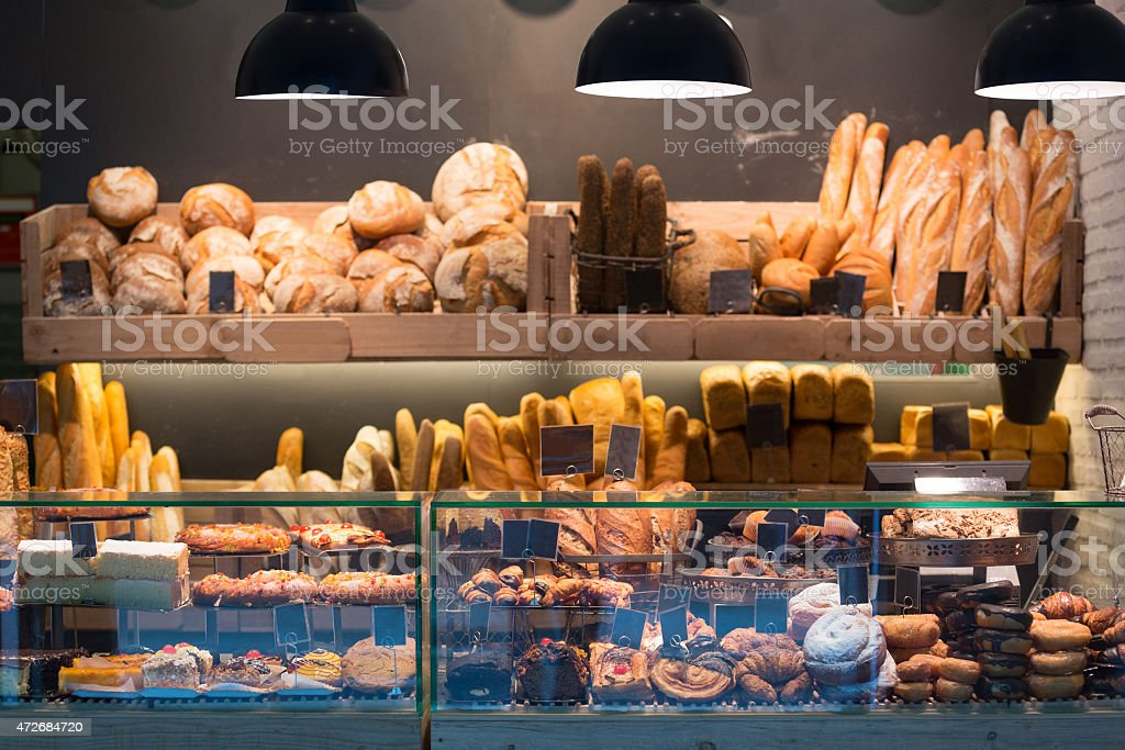 Modern bakery with different kinds of bread stock photo