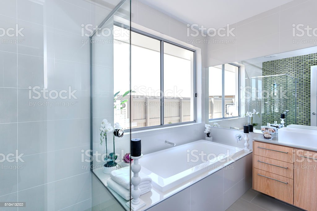 Modern bathroom and bathtub in a luxurious home stock photo