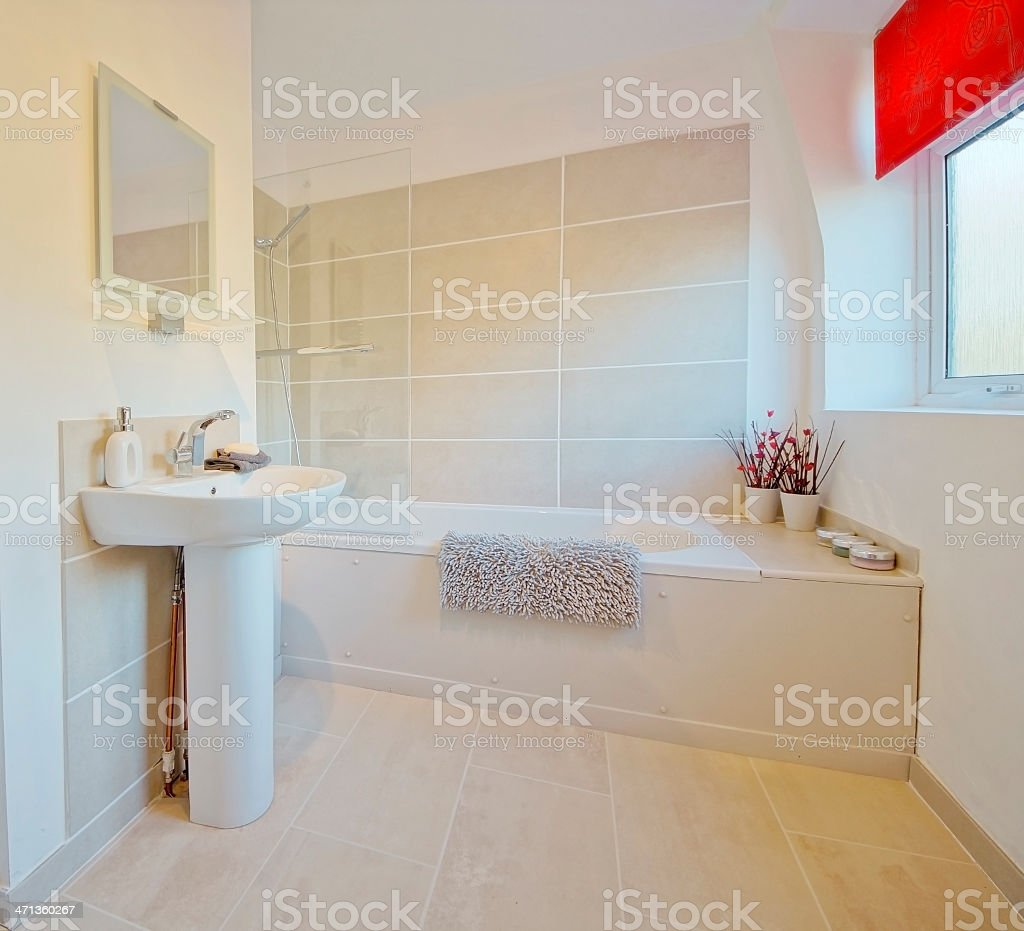 Modern bathroom decorated in white, beige, and red royalty-free stock photo