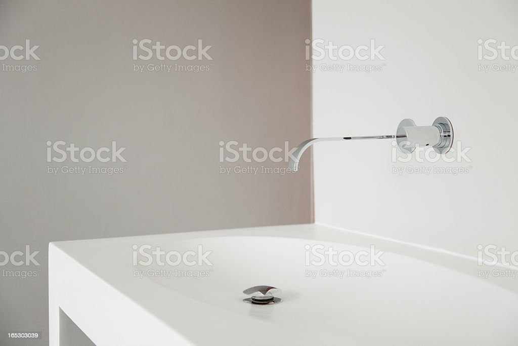 Modern bathroom faucet and sink stock photo