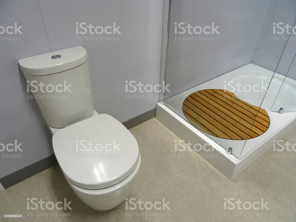Modern bathroom, glass shower enclosure, white shower tray, WC toilet stock photo