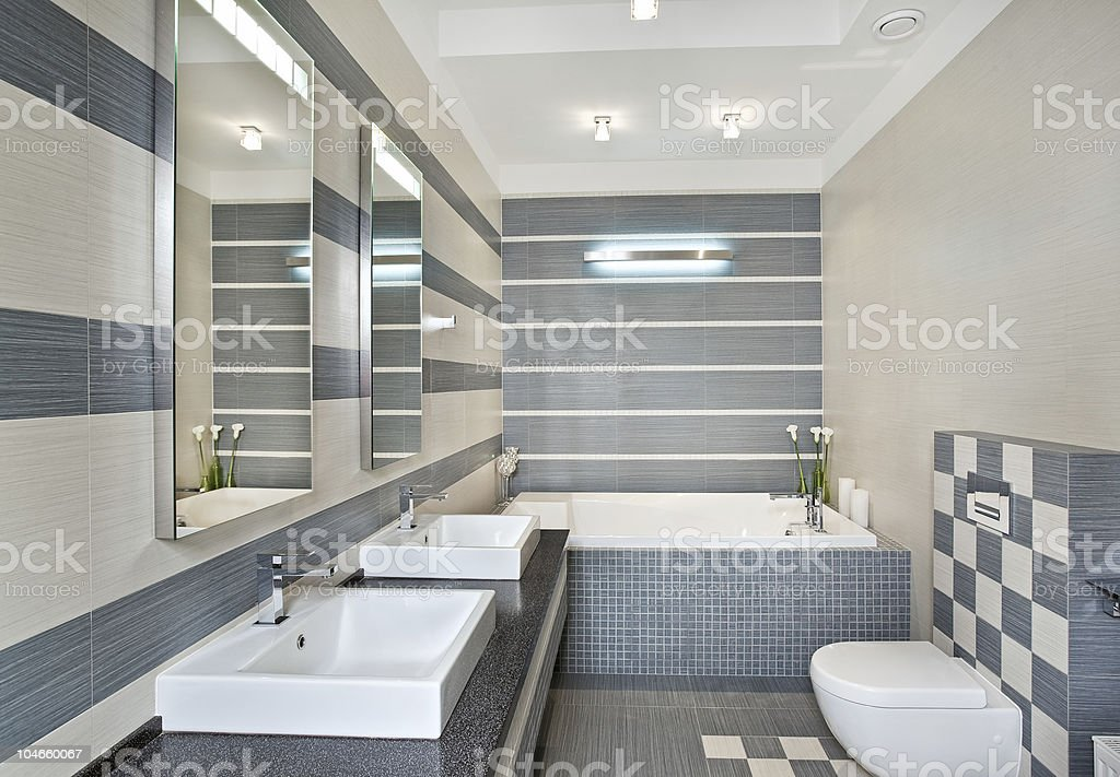 Modern bathroom in blue and gray tones with mosaic royalty-free stock photo
