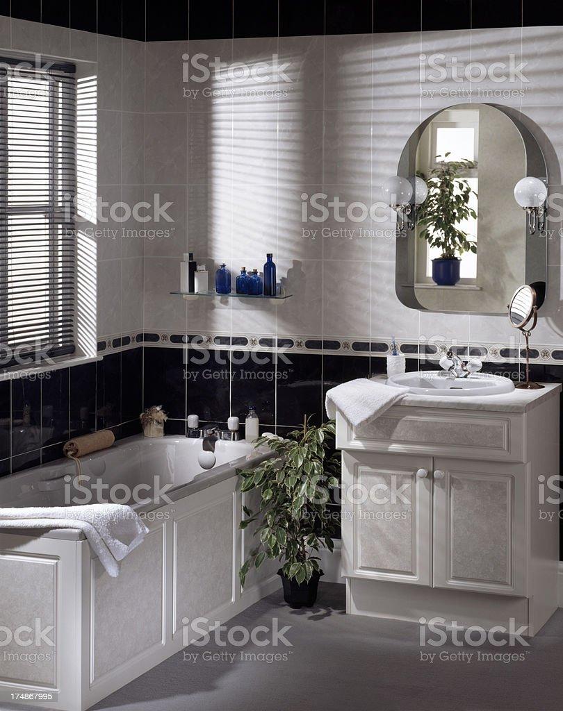 Modern bathroom interior with bathtub stock photo