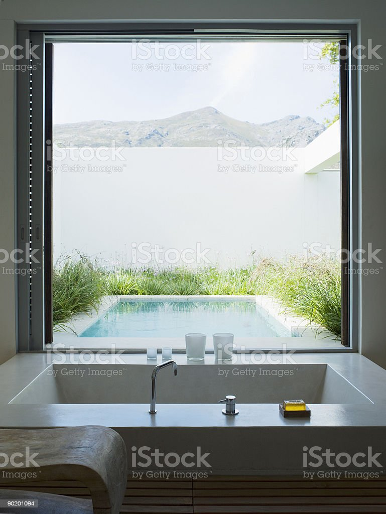 Modern bathroom looking out large window royalty-free stock photo