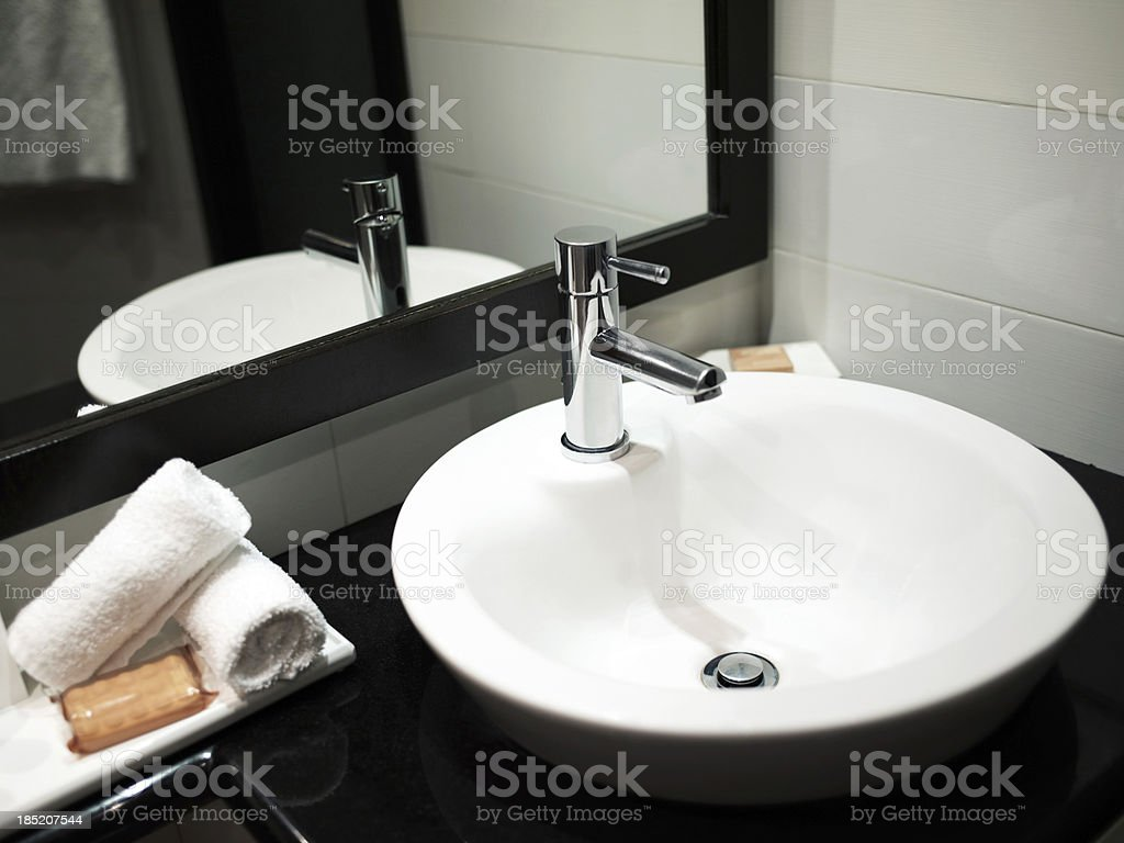 Modern bathroom sink with mirror reflection stock photo