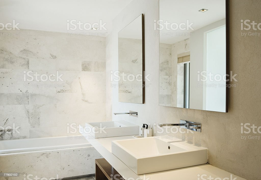 Modern bathroom vanity and bathtub stock photo