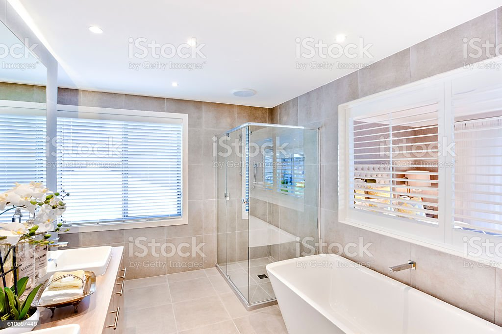 Modern bathroom with a washbasin and shower area stock photo