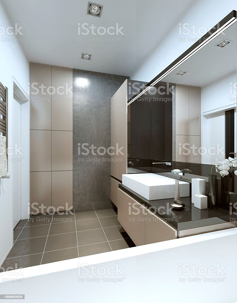 Modern bathroom with beige and gray furniture. stock photo