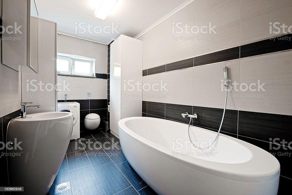 Modern bathroom with black tiles royalty-free stock photo