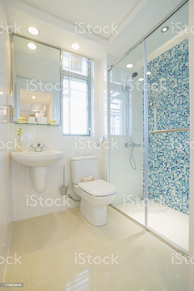 Modern bathroom with blue tiled shower design stock photo