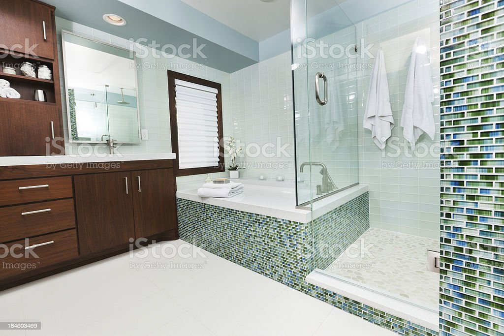 Modern bathroom with glass shower stock photo