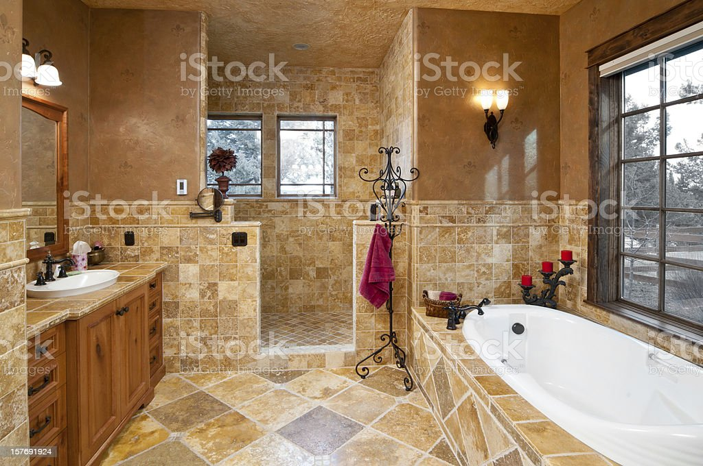Modern bathroom with sunken bathtub stock photo