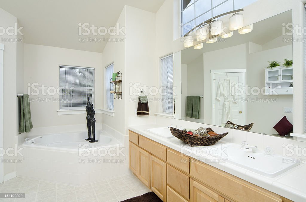 Modern bathroom with sunken bathtub stock photo