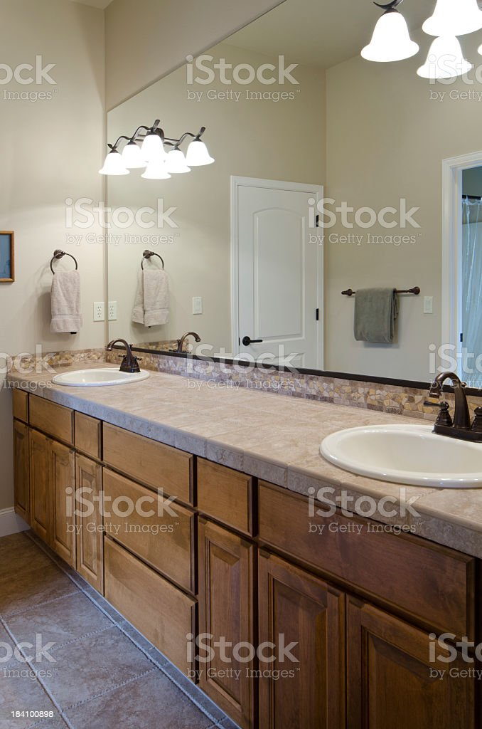 Modern bathroom with vanity mirror and two sinks stock photo