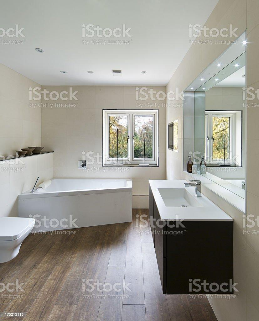 modern bathroom with wood floor stock photo