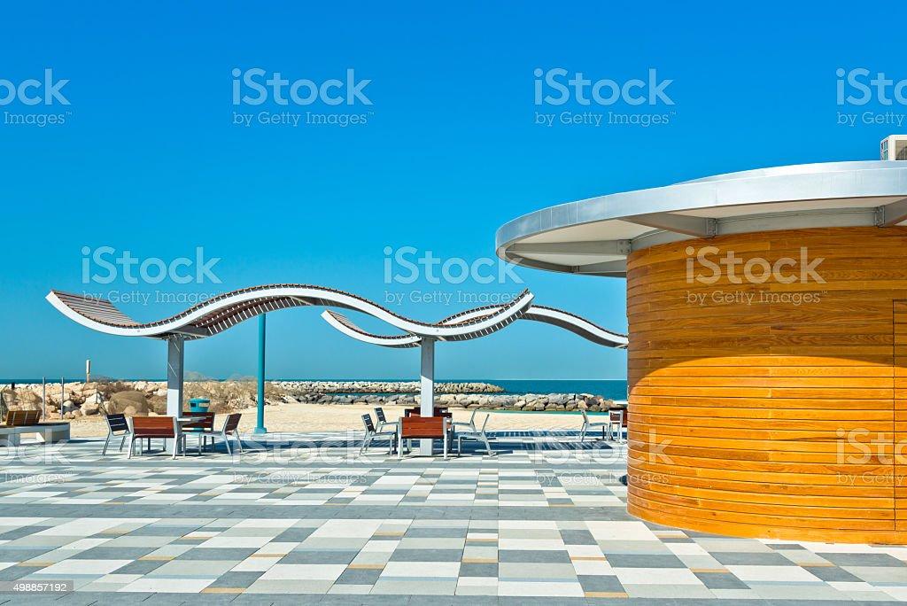 modern Beach with sunshade and bench in Dubai stock photo