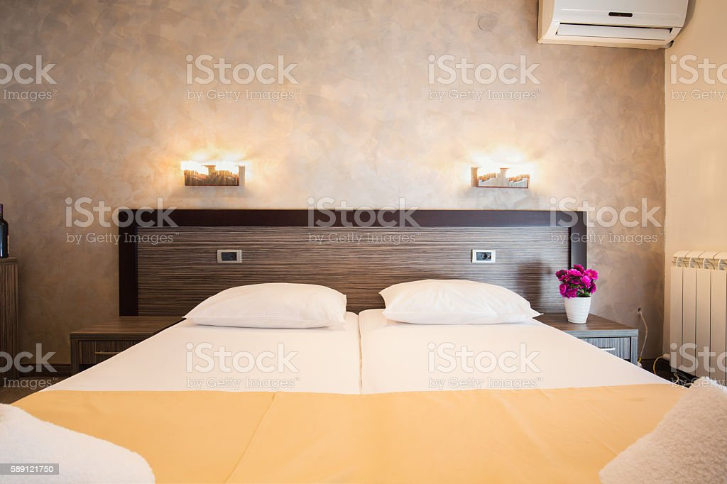 Modern beautiful hotel bedroom interior stock photo