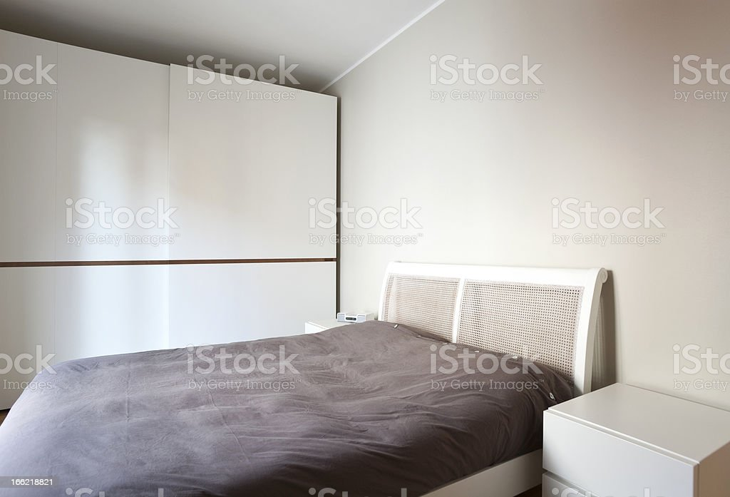 modern bedroom, double bed and wardrobe royalty-free stock photo
