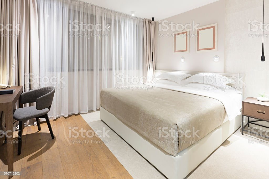 Modern bedroom interior in the evening stock photo