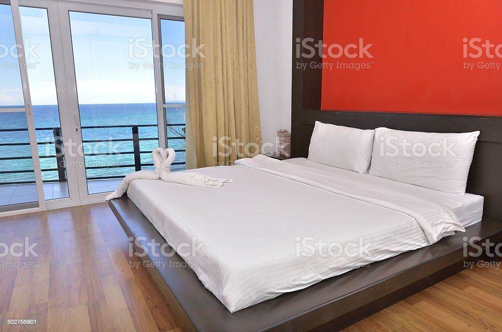 Modern bedroom interior with seascape view stock photo