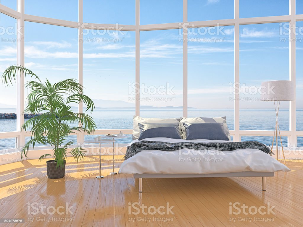 Modern bedroom interior with windows on cloudscape the sea stock photo