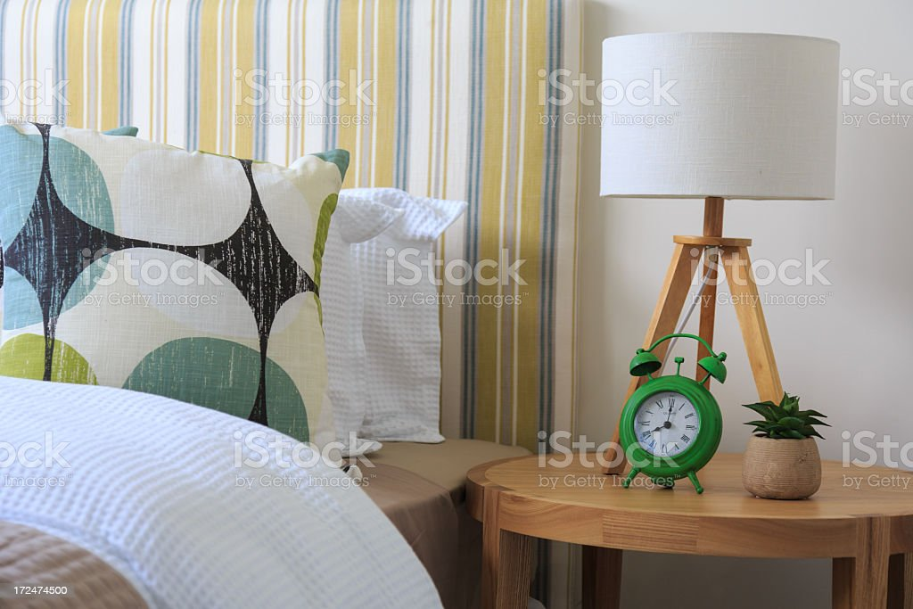 Modern bedroom with a green clock royalty-free stock photo