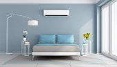 Modern bedroom with air conditioner