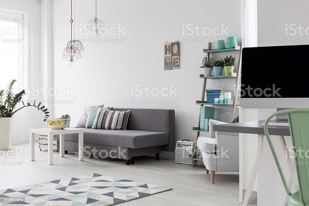Modern bedroom with bright wooden floor stock photo