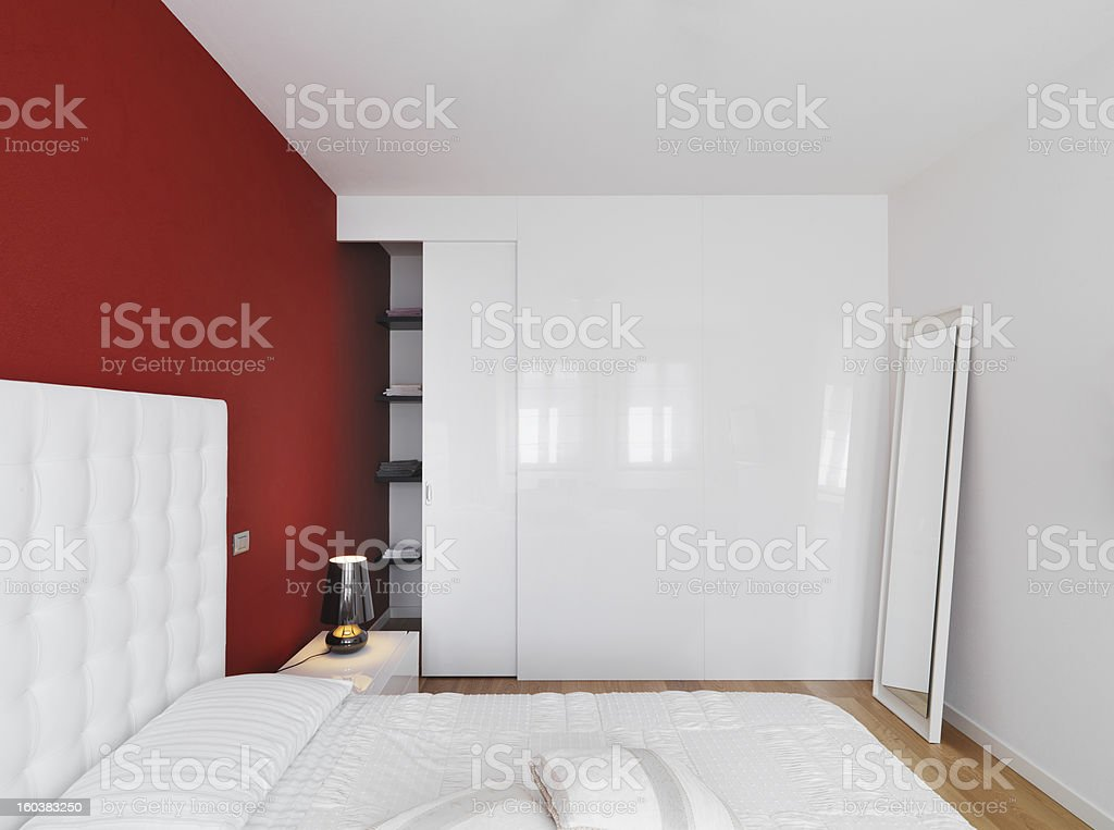 modern bedroom with red wall royalty-free stock photo