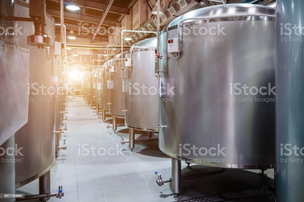 Modern Beer Factory. Small steel tanks for fermentation of beer stock photo
