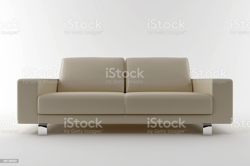 A modern beige leather sofa with chrome silver feet  royalty-free stock photo